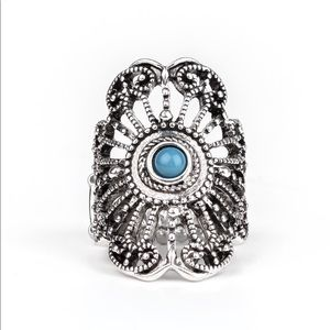 Cute metal ring with blue stone